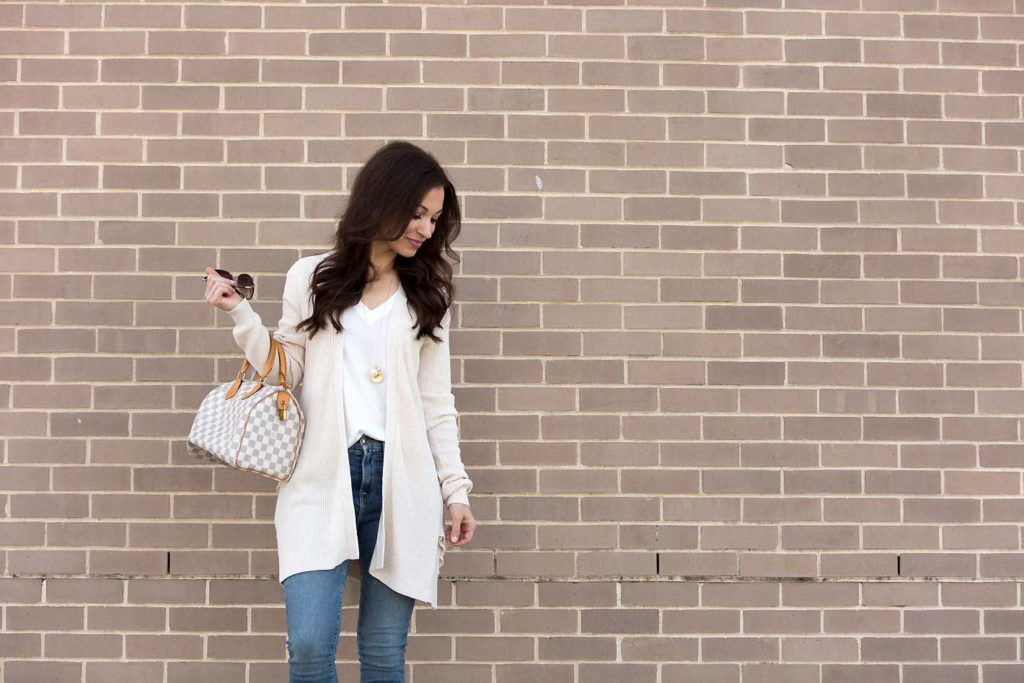 Alissa Weikel of Lipgloss & Labels wearing an ivory ruffle cardigan from the Nordstrom anniversary sale