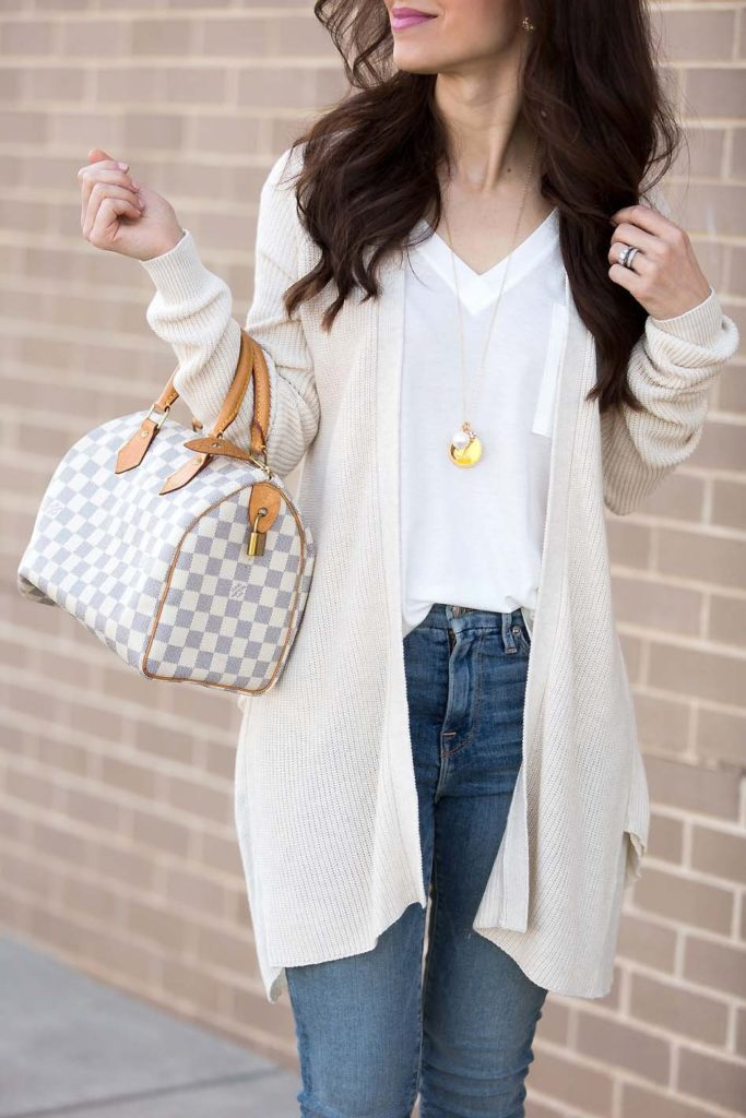 Ivory ruffle cardigan and high waisted jeans