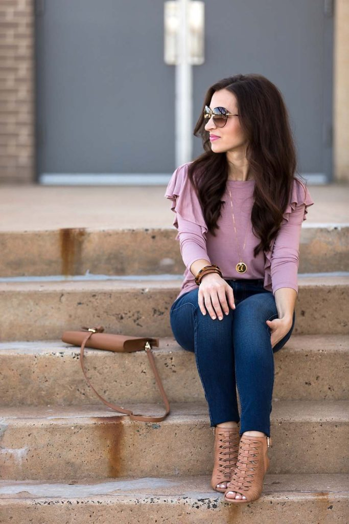 Alissa Weikel of Lipgloss & Labels wearing a dusty mauve ruffle knit top