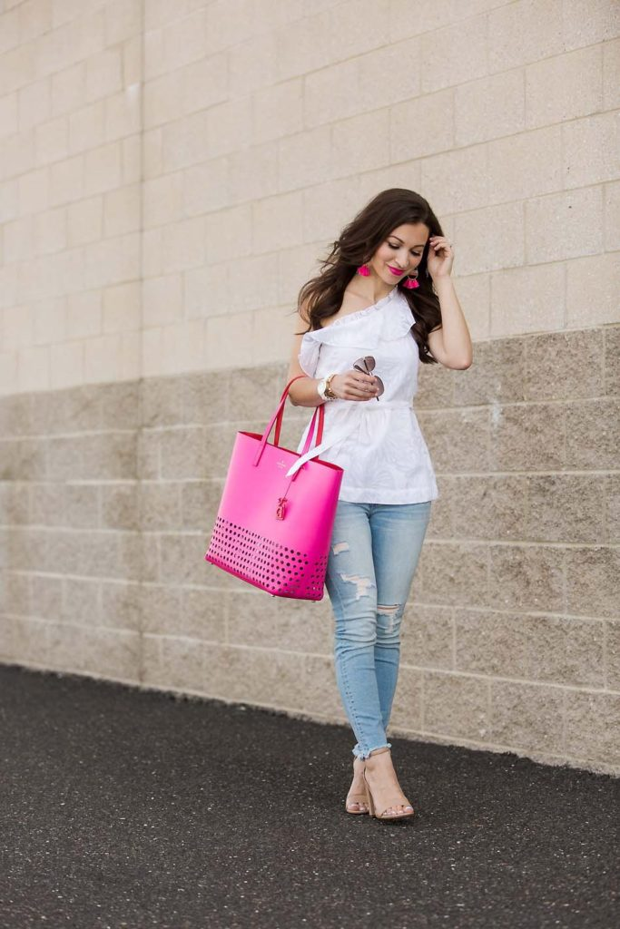 Alissa of Lipgloss & Label's wearing white top and a pink bag from Current Boutique