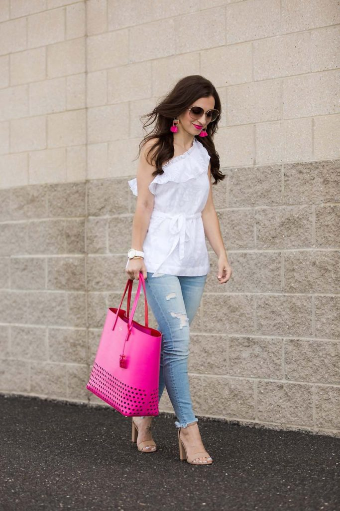 white one-shoulder top and pink Kate Spade tote from Current Boutique