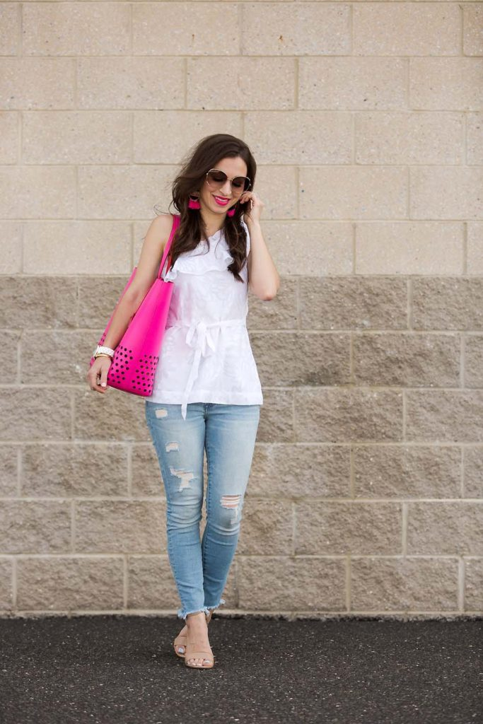 Current Boutique white one-shoulder top and pink Kate Spade tote