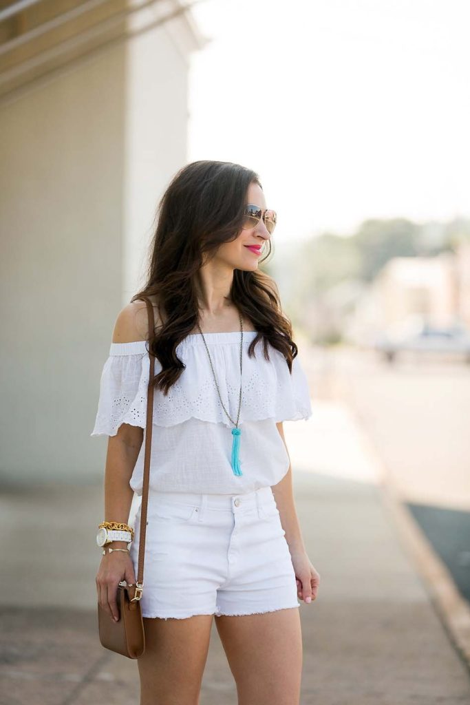 white off shoulder top and white jean shorts