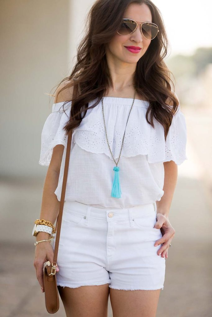 white off shoulder top with white denim shorts