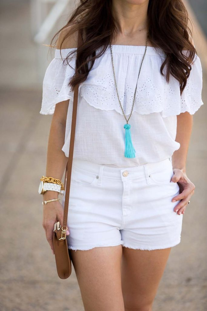 white off shoulder top and turquoise tassel necklace