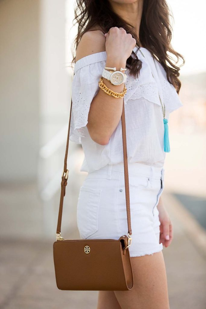 white off shoulder top and Tory Burch crossbody bag