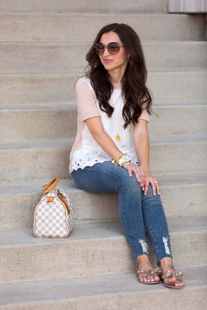 Alissa Weikel of Lipgloss & Labels wearing skinny jeans and an eyelet peplum sweater