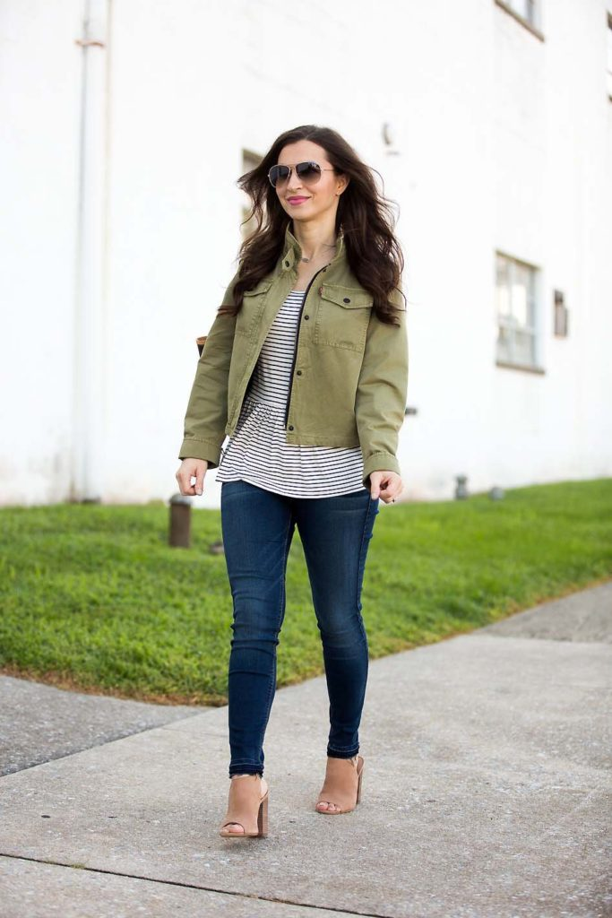 Alissa Weikel of Lipgloss & Labels wearing a striped peplum tee and olive green cropped jacket