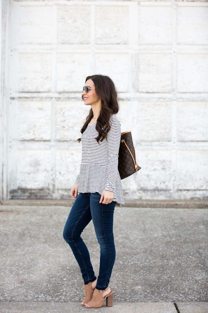 Alissa Weikel of Lipgloss & Labels wearing a striped peplum tee