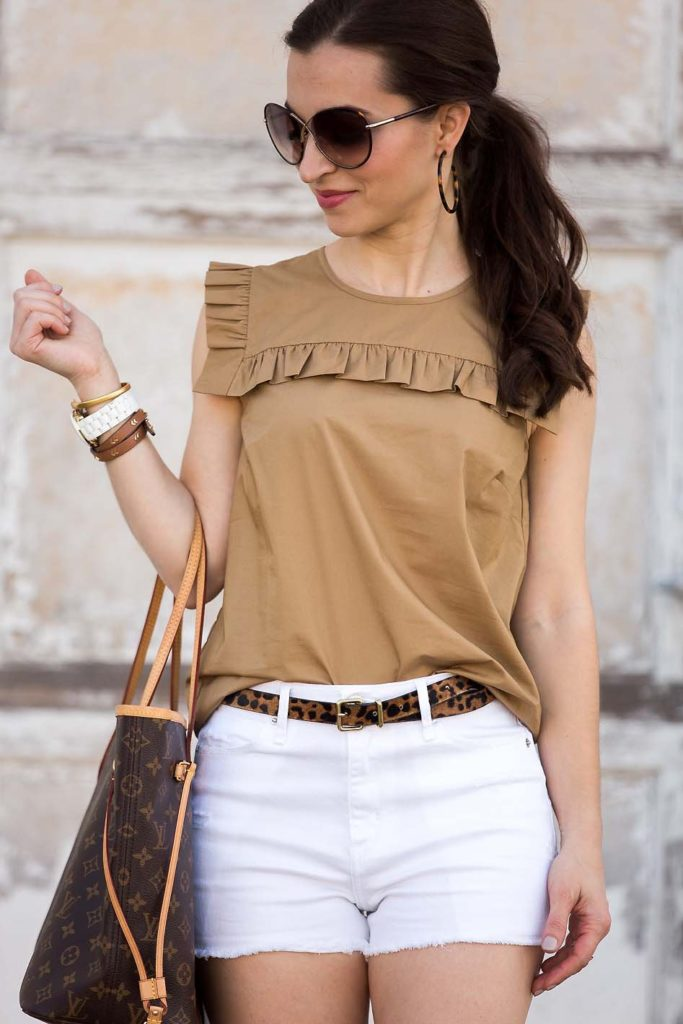 khaki ruffle top with white shorts and a leopard belt