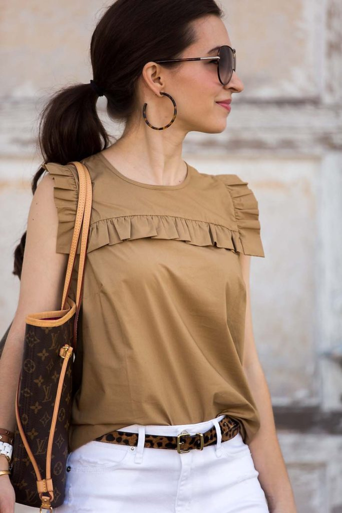 khaki ruffle top with white shorts and leopard belt