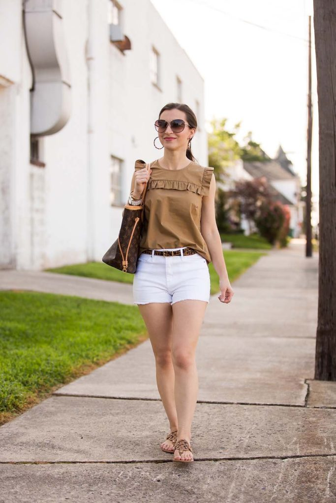 Alissa Weikel of Lipgloss & Labels wearing a khaki ruffle top and white denim shorts