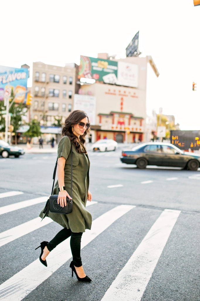 Alissa Weikel of Lipgloss & Labels wearing an olive trench vest with black denim