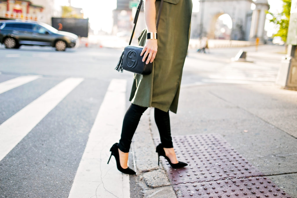 olive trench vest and suede pumps
