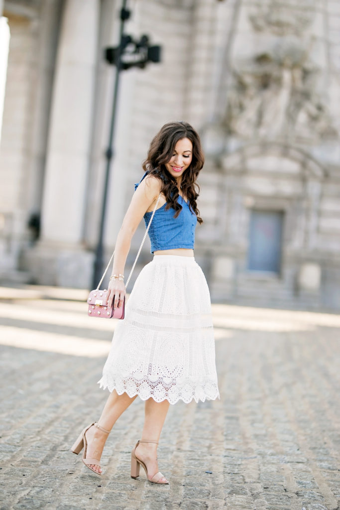 Alissa Weikel of Lipgloss & Labels wearing a white lace skirt and denim crop top