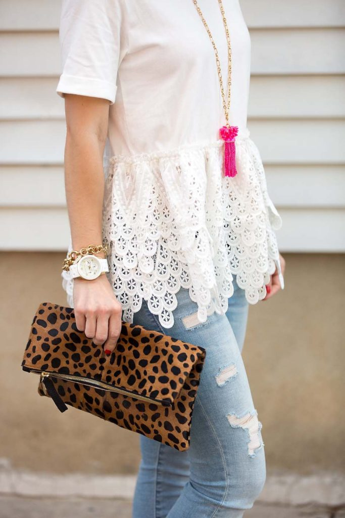 white lace peplum tee and leopard clutch