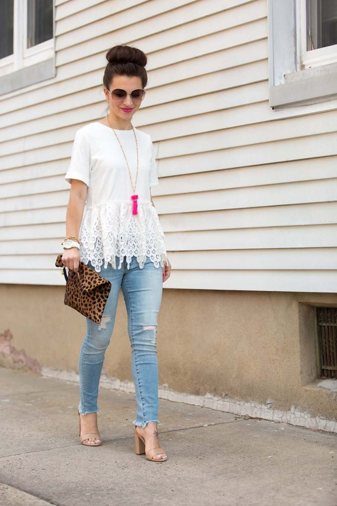 Alissa of Lipgloss & Labels wearing a white lace peplum tee