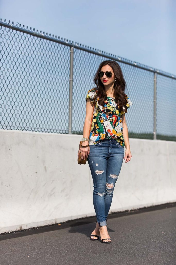 Alissa Weikel of Lipgloss & Labels wearing postcard print ruffle top