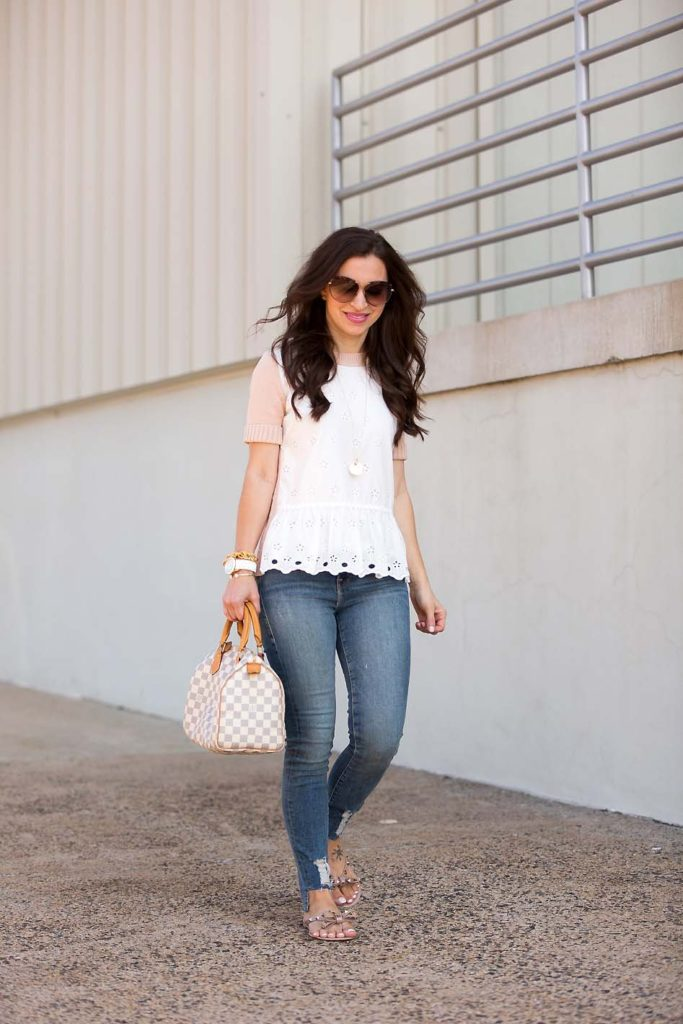 Alissa Weikel of Lipgloss & Labels wearing an eyelet peplum sweater with high waisted denim