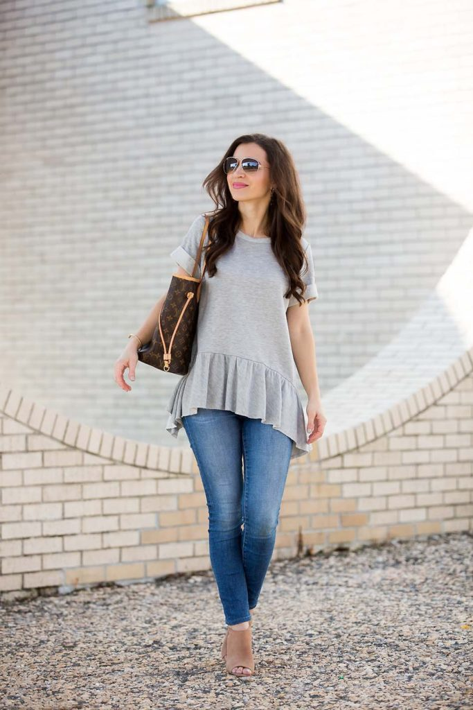 Alissa Weikel of Lipgloss & Labels blog wearing a grey peplum sweatshirt