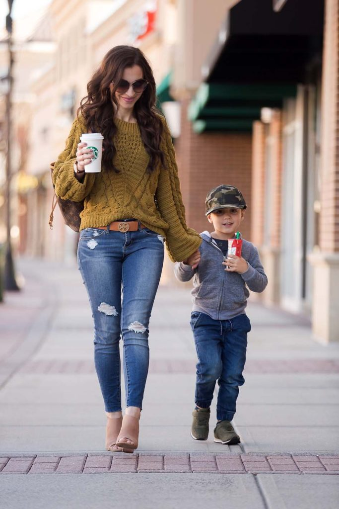 mother/son fall style olive sweater distressed jeans tory burch belt starbucks booties