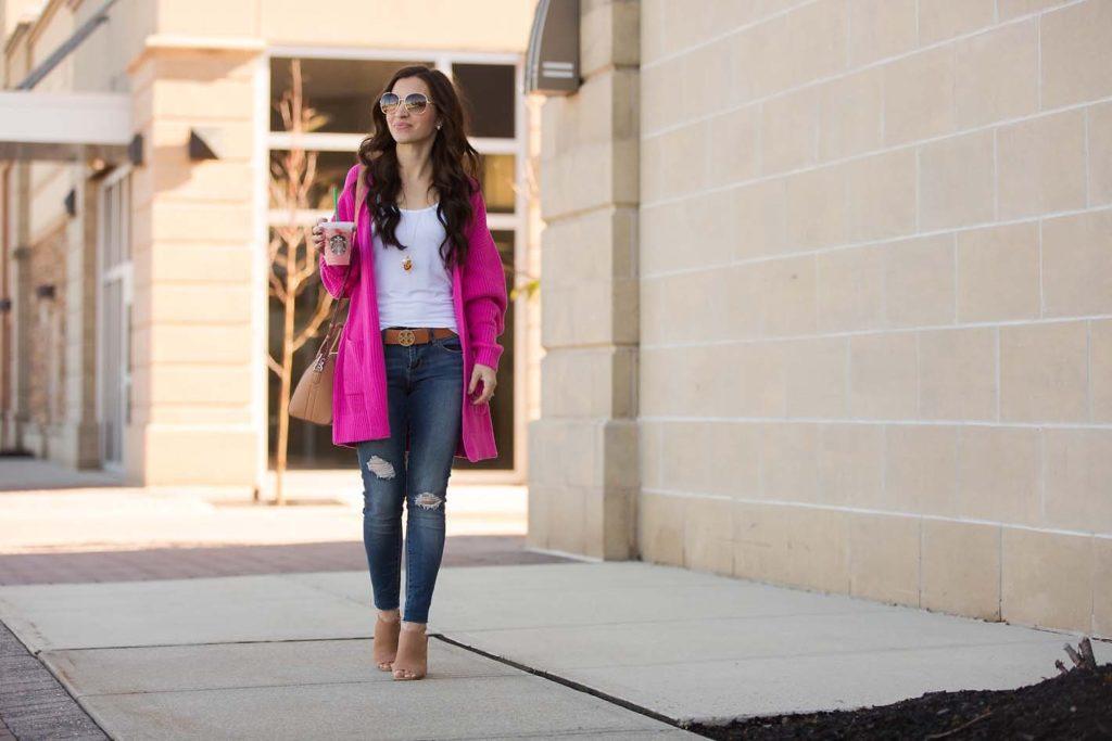 hot pink cardigan distressed skinny jeans Tory Burch belt
