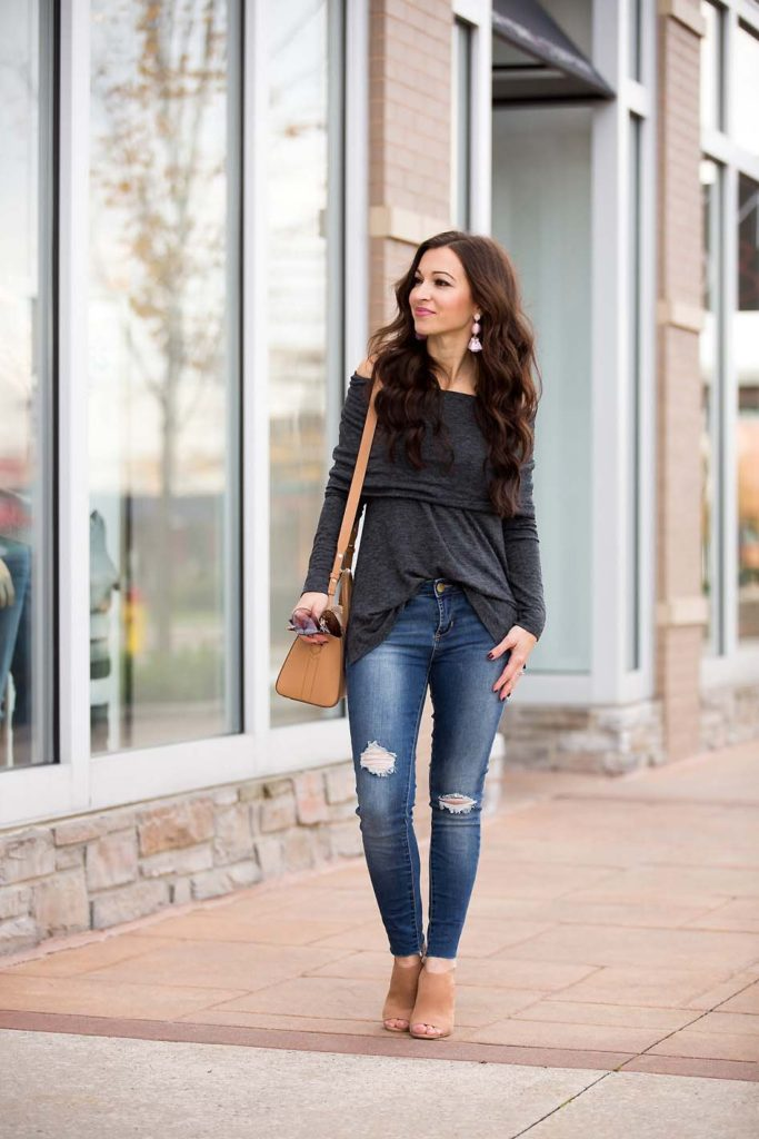 grey off shoulder top skinny jeans Givenchy Antigona peep toe booties