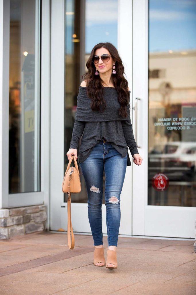 grey off shoulder top skinny jeans Givenchy mini Antigona peep toe booties