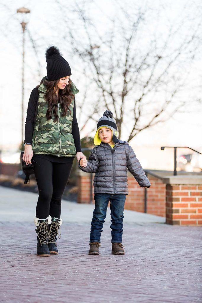 mother son winter style Kamik boots Camo vest black leggings grey puffer coat