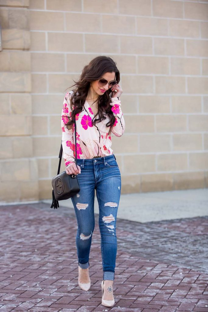 pink floral bodysuit ripped jeans Gucci Disco