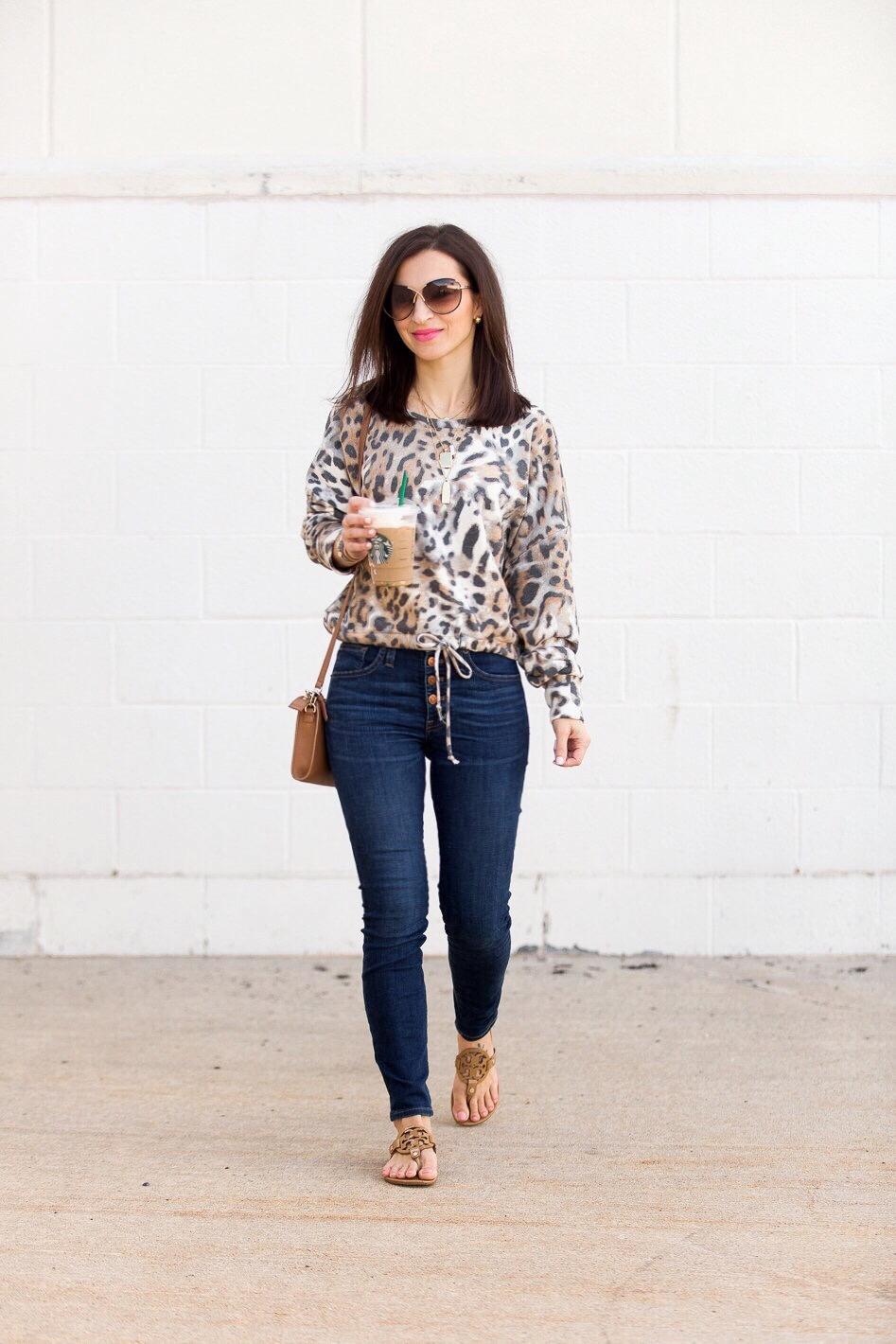 625a87ba600 cropped leopard sweatshirt high waisted jeans tory burch miller sandals